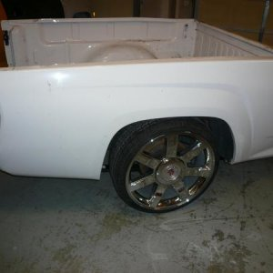 "Here is the new bed on the frame with my 7"" drop on 255/30/22 wheels. I did not notch the frame."