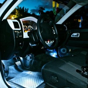 driver door open, White LED footwells, Painted trim